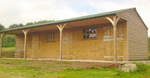 stables-store-green-onduline-roof