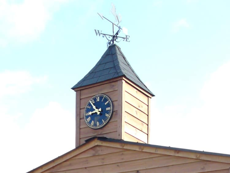 listed building with a clock